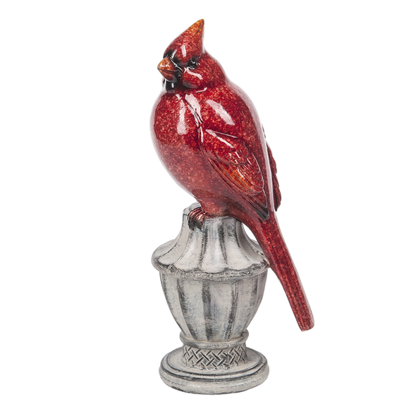 """Beautiful cardinal on classic white pedestal looks lovely in a floral centerpiece or featured in a winter display. 3"""" W. x 2 1/2"""" D. x 7 1/4"""" H. Resin"""