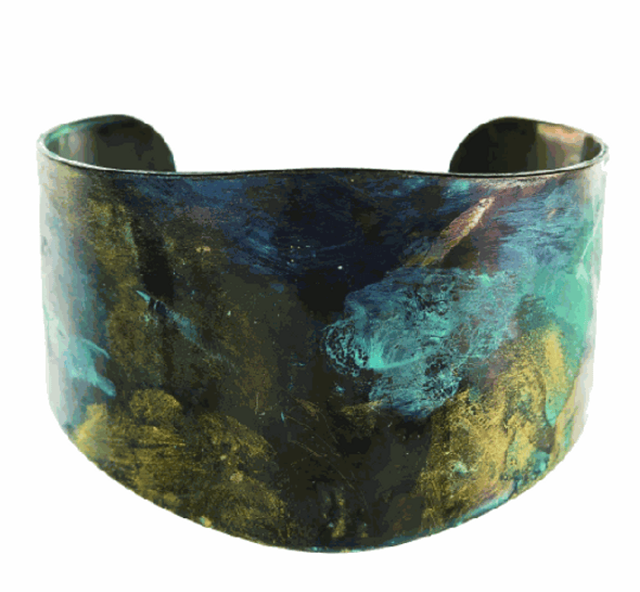 """Fire Rainbow Earthy Patina Wide Cuff Bracelet has natural color variantions- metallic brass, turquoise, verdigris patina, and gray- natural differenes so each is unique and resemble raku pottery. One size fits most. 1 1/2"""" at widest point across cuff, with open back. Cuff can be gently squeezed to shape."""