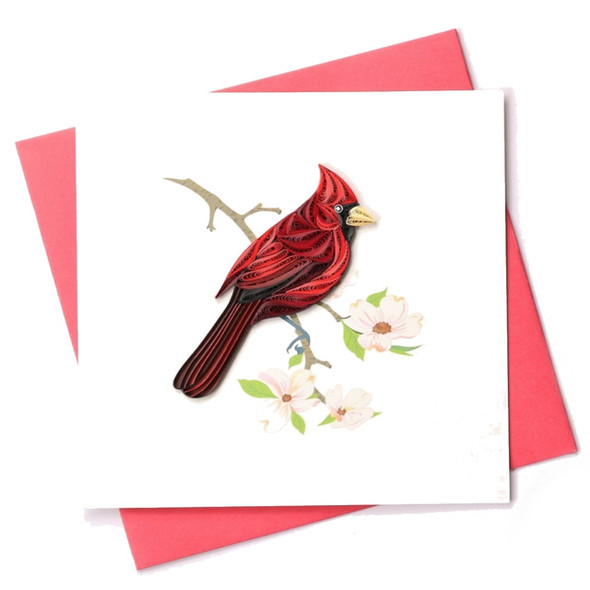 """This beautiful dimensional card is blank inside so you can add your own sentiment, or just frame in a shadowbox because it is exquisitely crafted. Each is handmade using traditional paper-curling """"quilling"""" technique and meticulously glued into place against a pastel watercolor background. The cardinal is a symbol of the memory of our loved ones. This fancy fellow appears to perch on a dogwood blossom. A perfect artistic keepsake that will be treasured for years to come. Comes with a red envelope. 5"""" square."""
