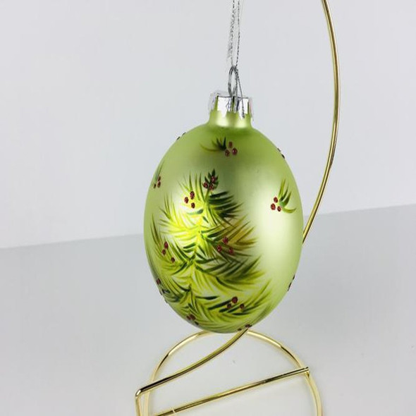 Light green glass ball. Hand painted tree with red sparkling dots for holly. Will bring some more elegance to your Christmas tree.