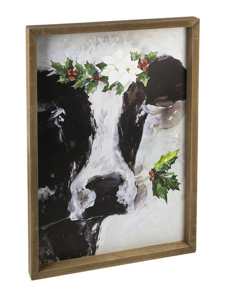 "Festive black and white cow with holly in a wood frame. 14 1/4"" W. x 1 1/4"" D. x 20"" H."