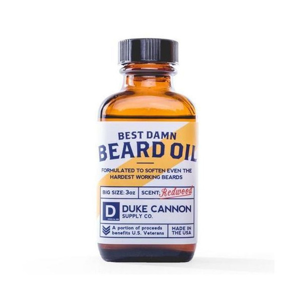"There is a fine line between the unruly beard of a grizzled mountain hobo and the dashing beard of a world champion. Go from unkempt to ""kempt"" with Duke Cannon's Best Damn Beard Oil. Made with premium natural ingredients such as Apricot kernel, argan, and jojoba oils, it's formulated to soften even the hardest working beards. Rich in vitamin e, carotenes, and antioxidants, these oils are considered beneficial against psoriasis, eczema, and acne. At 3X the size of the competition, our Beard Oil will last much longer, and it features an amber apothecary bottle with a slow drip pour top to reduce spills. Features the scent of freshly split cedar, making you feel like you're on a walk through the Redwoods.  3 oz. bottle."