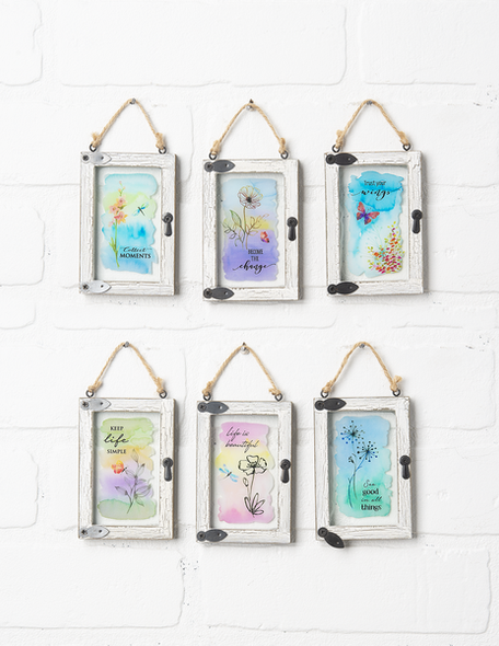 """Mini window ornaments come in six assorted designs.  Sold individually.  Dimensions:  2 1/2""""W. x 1/2""""D. x 3 3/4""""H."""