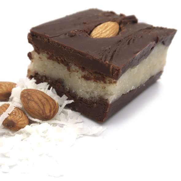 <p>2 thick layers of chocolate fudge with a solid middle layer of coconut and topped with almonds.</p>