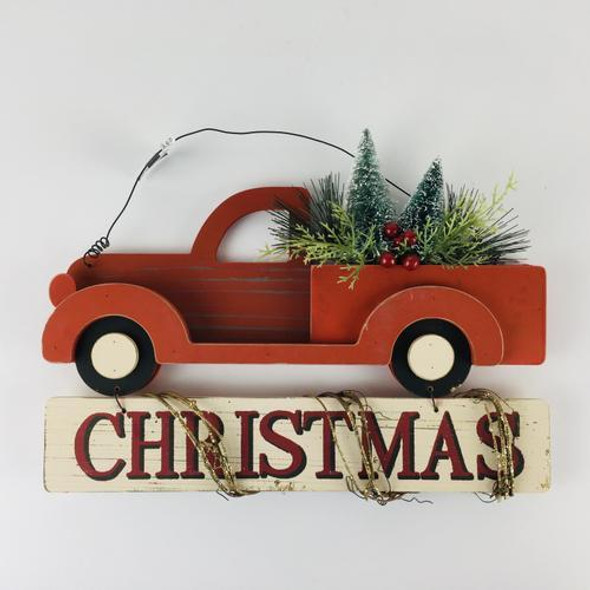 Layered wooden pieces put together to make an adorable hanging Christmas sign.