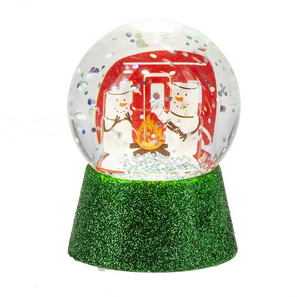 Collectible Marshmallow S'mores sit around the campfire in this mini snowglobe. Globe lights up and contains swirling glitter flakes.