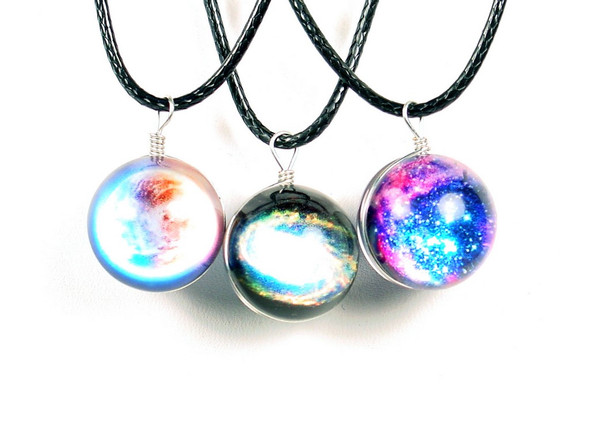 "Different views of the solar system inside each 3/4"" marble. Corded necklace is 9 inches long and appropriate for girls, boys, or anyone who enjoys stargazing and science.  Each necklace sold individually.  Comes in three assorted designs."