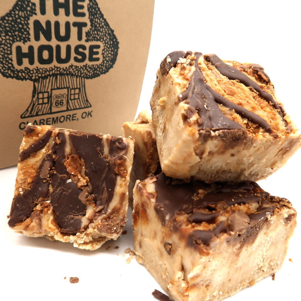 <p>Vanilla Fudge mixed with Butterfinger candy. Best seller!</p> <p><strong>Each pound is cut into 4 thick 1/4 pound squares. That's a lotta fudge!!</strong></p> <p><strong><span>PLEASE ACKNOWLEDGE  </span>Some fudge can take 72 hours to ship if not already made. Call for availability. 918-266-1604</strong></p>