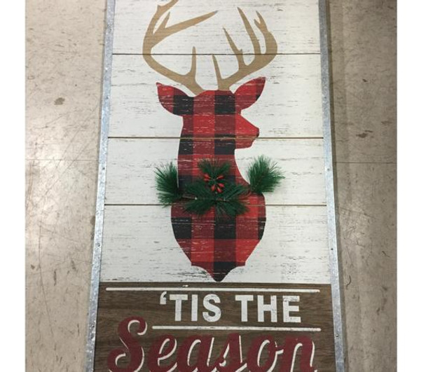 """''Tis the Season' to celebrate the holidays with this classy stag on a wood plank panel trimmed with riveted tin. Stag silhouette With plaid fill and dimensional faux fir trim looks great with classic, lodge, country, farmhouse, or rustic decor. 13 """"W x 23 1/4"""" x 1/2"""" D"""