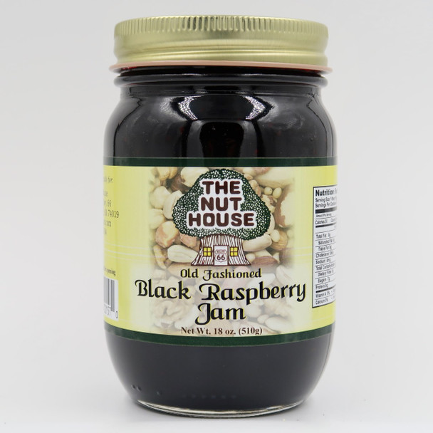 """Remember picking wild berries out on the fence on a warm summer afternoon? Get that fresh natural taste in a jar with our delicious Black Raspberry Jam (18oz) is """"Just Naturally Good."""" It is 100% all-natural with no artificial colors or sweeteners. The delicious flavor floats out of the jar! Ingredients: Sugar, black raspberries, water, pectin, citric acid. (Produced by equipment handling nuts.)"""