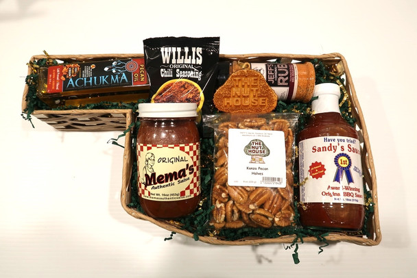 Our Taste of Oklahoma Gift Basket includes an assortment of products that are made in Oklahoma.  This basket includes; Nut House Laser Ornament, 8 oz bag of Kanza Pecan Halves, a jar of Mema's Original Authentic Salsa, a bottle of Sandy's Original BBQ Sauce, a package of Willis Original Chili Seasoning, Jeff's Original Rub and a bottle of Achukma Pecan Oil*.  All in a collectible 18-inch woven basket in the shape of Oklahoma! *Items subject to substitution based on availability