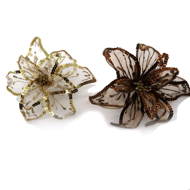 "With a clip-on feature, this flower ornament is easy to attach to the tree. Flower is designed with sequins and glitter and each petal is wired and easy to shape as desired. Sequins line the edges of each mesh petal. When formed flower is about 7"" across. Choose copper or gold."