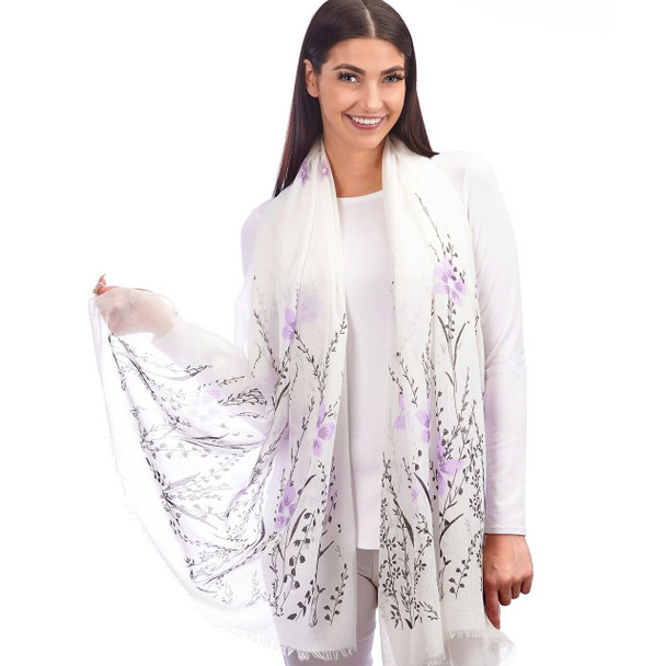 This white scarf with a purple and green floral design is the perfect accessory for adding lightweight warmth to an outfit. Polyester. 70.9X27.6(in)