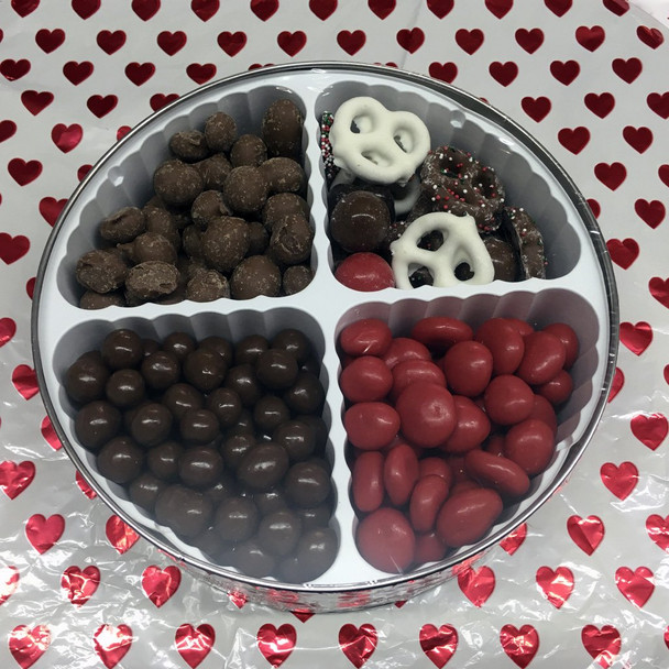"""Anyone's sweetheart will love these four delicious favorites! Red Chocolate cherries, Chocolate Covered Cookie Dough, Double Dipped Dark Chocolate Peanuts and """"Happy Heart"""" Mix (White chocolately pretzels, chocolate non-pareils, red and milk chocolate malt balls, and yogurt covered cranberries."""