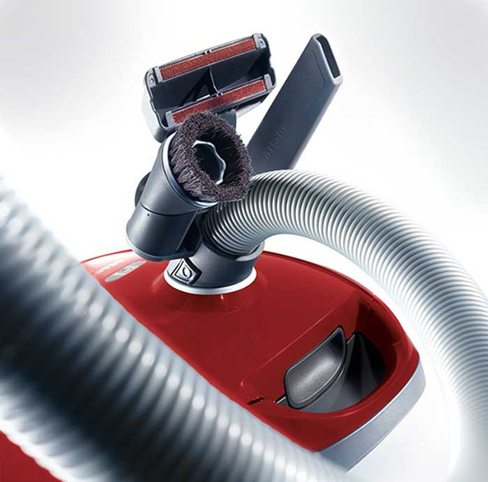 Tools conveniently clip onto hose.
