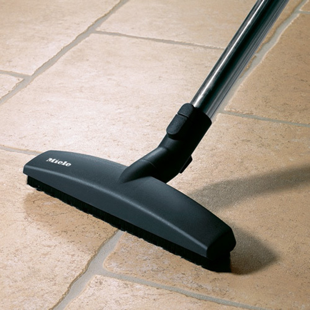 "12"" floor brush with wheels on both sides for gentle cleaning."