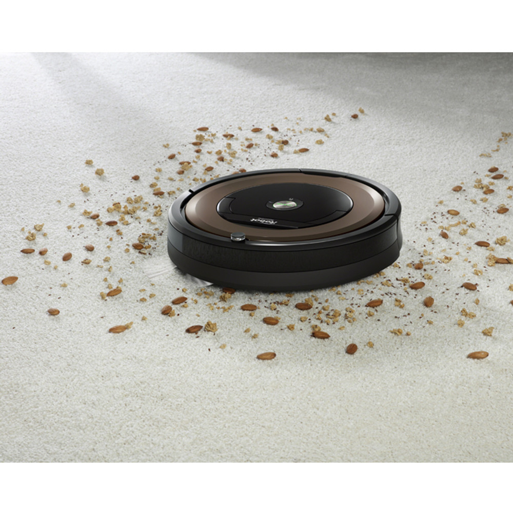 Roomba 890 Cleans Debris from Carpeting