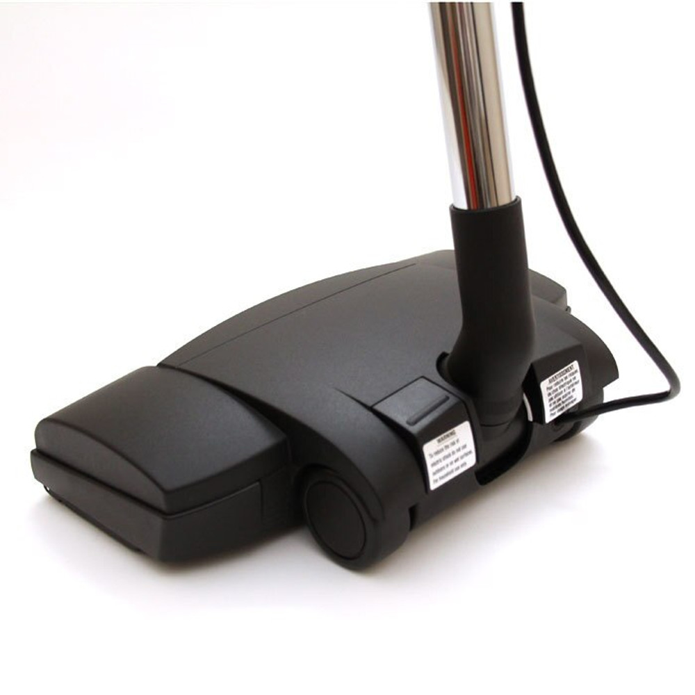 German made, electric power nozzle self adjusts for all carpet types.