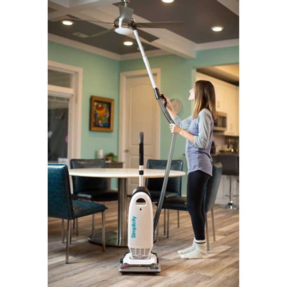 Vacuum with extended reach for cleaning fans and high shelves