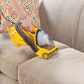 Rotating Brush Bar Cleans Upholstery