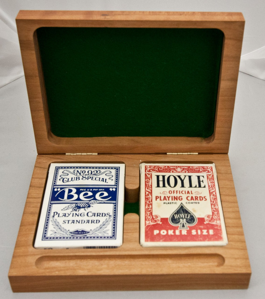 Our custom playing card boxes can be engraved with anything you want. They will hold two decks of cards plus a pencil for keeping score.