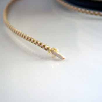Gold and white cloth wire