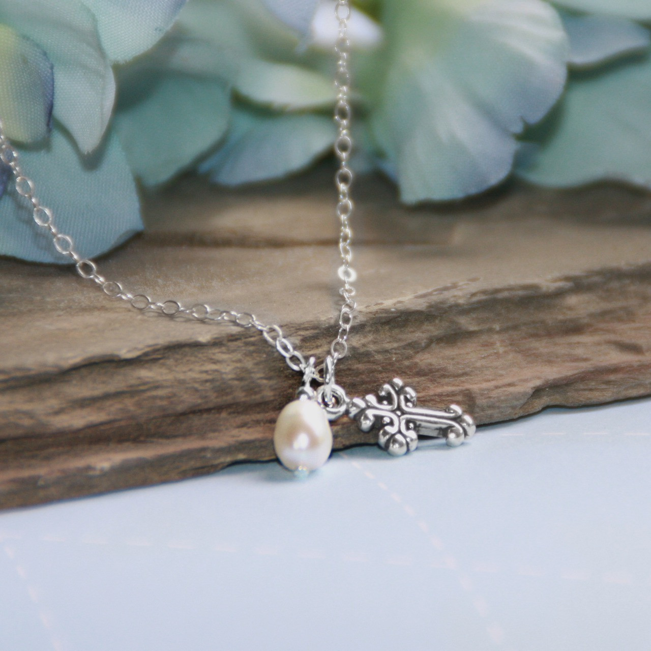 STG-140  Another Sterling Silver Top Selling Cross Necklace with added Freshwater Pearl