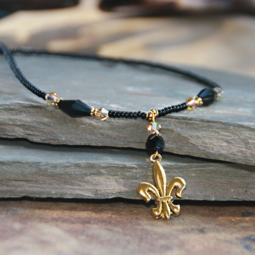 NOST-1  Beautiful Saints Black and Gold Necklace