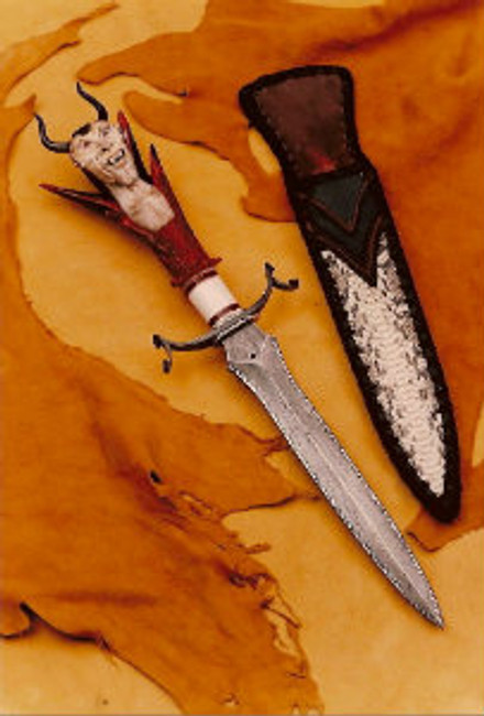 "An all-out fantasy piece, ""Sentry of Tartarus"". A master bladesmith Daniel Winkler forged damascus double-sided and flame edged knife with damascus scalloped and artistically curled guard, multiple spacers, including a fileworked nickle silver pair. Whitetail deer crown stag and India Sambar stag carving with ant hill garnet eyes, water buffalo horns. Stand with twisted iron supports and fantasy sheath. 15"" overall length."