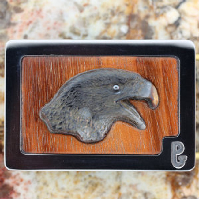 Carved Picasso marble eagle head with hematite eye by Paul Grussenmeyer mounted on Tigerwood in Paul's signature stainless steel belt buckle.
