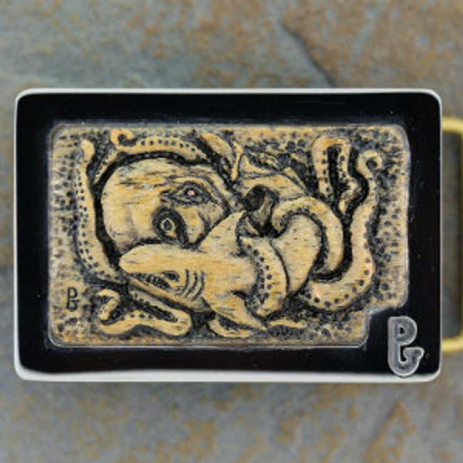 Belt Buckle with octopus & shark battle carved on fossil Stellar's Sea Cow rib bone by Paul Grussenmeyer. Mounted in Paul's signature series stainless steel belt buckle.