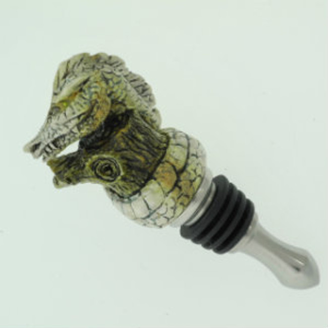 Bottle stopper with carved India Sambar crown stag dragon wrapped around a tree stump by Paul Grussenmeyer. Peridot eyes. Stainless steel stopper. Sculpture unscrews for use on other style stoppers.