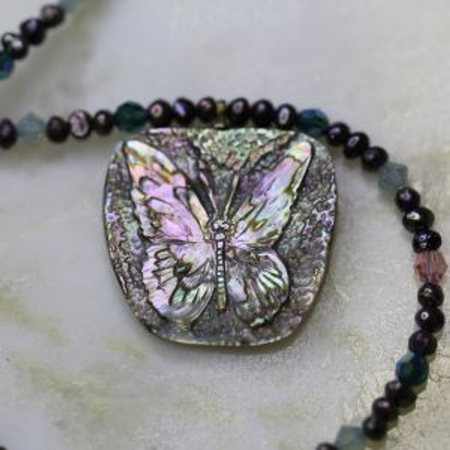 "Abalone butterfly carved by Paul Grussenmeyer, hung on a 17.75"" necklace of seed pearls and Swarovski crystals, with 14kt gold toggle clasp"