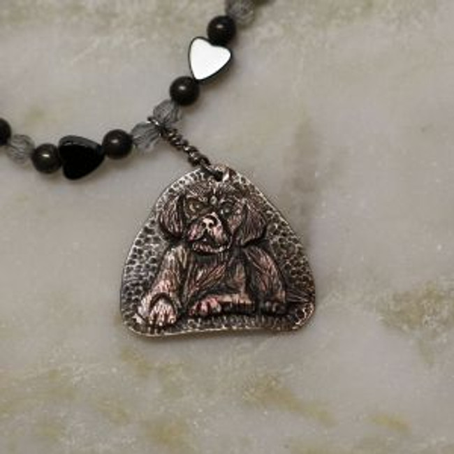 "Paul Grussenmeyer carved black pearl puppy with pearl eyes on a 16 1/8"" necklace of hematites, Swarovski crystals, silver plated beads and clasp"