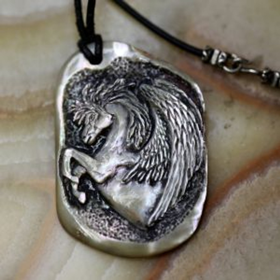 """Paul Grussenmeyer carved PEGASUS on a nice nature-polished piece of red abalone shell, hung from a 17.5"""" black Greek leather cord with an aged sterling silver clasp"""