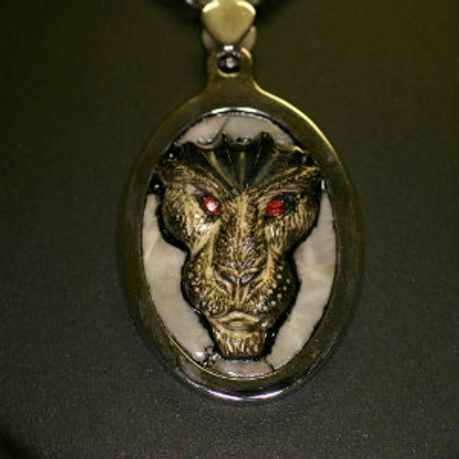 "Paul Grussenmeyer carved black marble Egyptian themed lion face with pieced gray marble background mounted in a stainless steel pendent, hung on a 24"" stainless steel wheat chain necklace with toggle clasp."