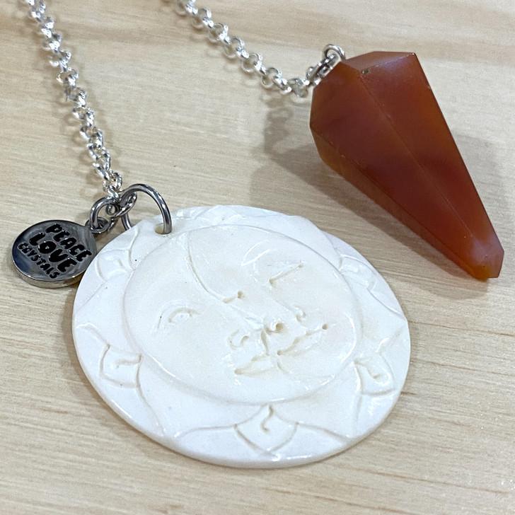 Carnelian Point with Sun and Moon Pendulum