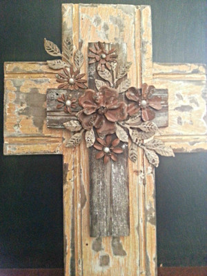 Distressed wood wall cross with tin flower embellishment