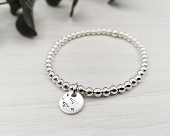 Silver Beaded Bird Bracelet