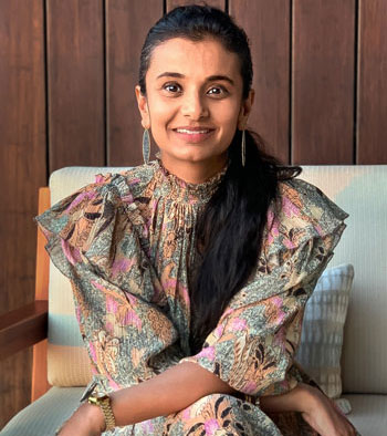 Founder Shreya Patel sitting in a chair