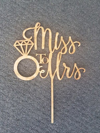 Miss to Mrs Cake Topper #1 Simply decorate this MDF design however you like - paper, paint, glitter, embossing powder or leave it as is! Addition of Gold or Silver Glitter is an Additional $5 - purchase the additional glitter listing for this option. 150mm wide is the Standard Size Note: Wrap the sticks in foil or cling wrap before putting into the cake to avoid the MDF from going soggy. If you need this design smaller or larger to fit your cake size, let us know and we can resize it. We also produce custom designs - see the custom design listing for this option.
