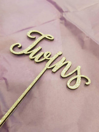 Twins MDF Cake Topper A cake topper perfect for the top of a baby shower cake or newborn cake! Simply decorate this MDF design however you like - paper, paint, glitter, embossing powder or leave it as is! Addition of Gold or Silver Glitter is an Additional $5 - purchase the additional glitter listing for this option. 150mm wide is the Standard Size Note: Wrap the sticks in foil or cling wrap before putting into the cake to avoid the MDF from going soggy. If you need this design smaller or larger to fit your cake size, let us know and we can resize it. We also produce custom designs - see the custom design listing for this option.