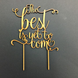 The best is yet to come Cake Topper MDF Laser Cut Inhouse by Imagine If.  Simply decorate this MDF design however you like - paper, paint, glitter, embossing powder or leave it as is!  Addition of Gold or Silver Glitter is an Additional $5 - purchase the additional glitter listing for this option.  150mm wideis the Standard Size N  ote: Wrap the sticks in foil or cling wrap before putting into the cake to avoid the MDF from going soggy. If you need this design smaller or larger to fit your cake size, let us know and we can resize it. We also produce custom designs - see the custom design listing for this option.