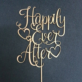 Happily Ever After Cake Topper MDF Laser Cut Inhouse by Imagine If.  This cute cake topper is perfect for on top of an engagement or wedding cake! Simply decorate this MDF design however you like - paper, paint, glitter, embossing powder or leave it as is!  150mm wide  Note: Wrap the sticks in foil or cling wrap before putting into the cake to avoid the MDF from going soggy. If you need this design smaller or larger to fit your cake size, let us know and we can resize it. We also produce custom designs - fill in a contact form on the Contact Us page and we can give you a price.
