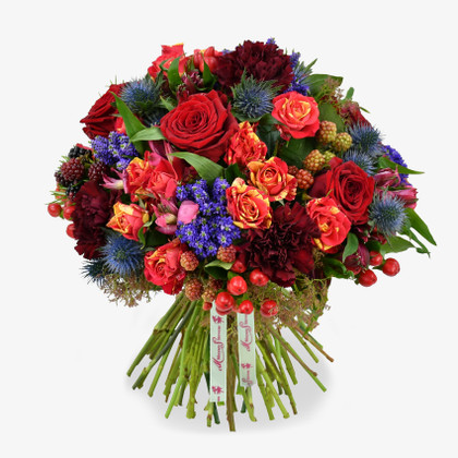 Thistles, rubus and scarlett berries are entwined to create this romantic and extravagant bouquet.