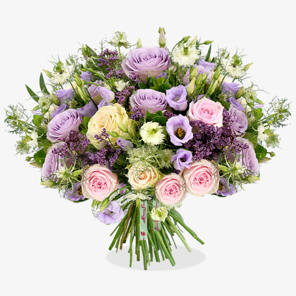 A magical, pastel palette encapsulates this charming design; with roses and lisianthus taking pride of place
