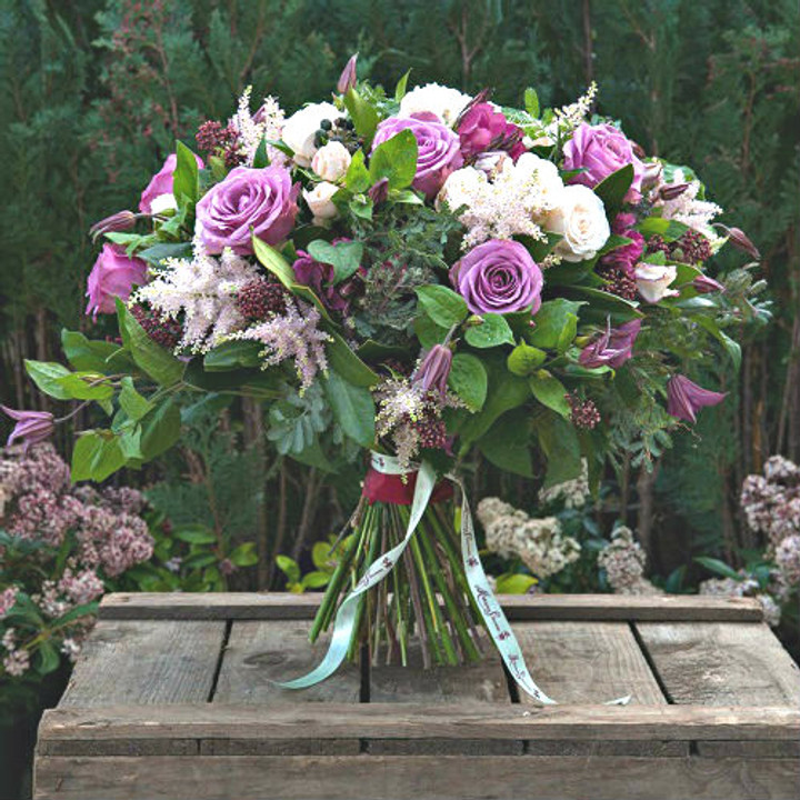 'Cool water' roses, 'Bombastic' roses, Astilbe and Blue Clematis