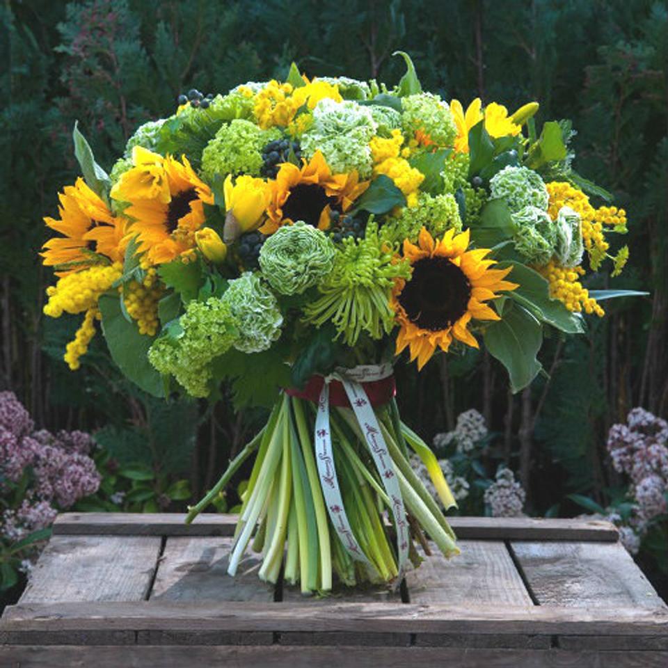 sunflowers, shamrock, guelder, mimosa, yellow freesia and ranunculus