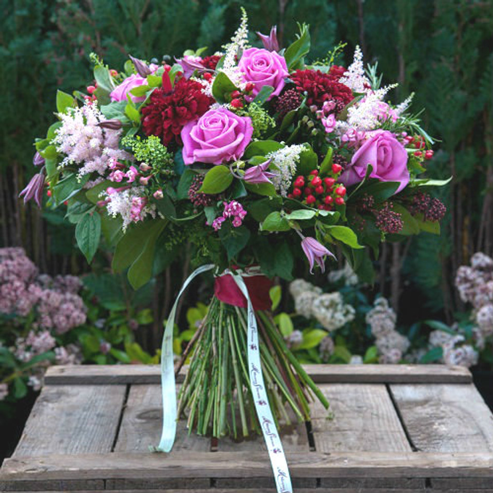 keano roses, astilbe, clematis, red hypericum, pink celosia and red skimmia