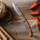 Folding Knife with engraved outdoor tool design open